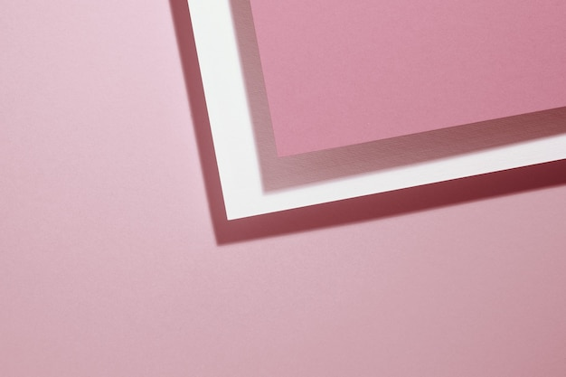 Modern pink background with sheets of paper with shadow. template for business, flat lay