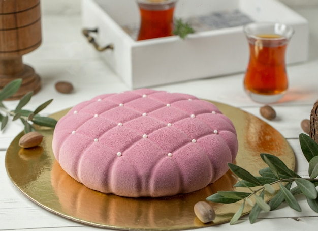 Modern pink cake in cushion shape with small pearls
