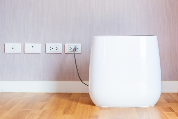 Modern portable air purifier in the room close up.