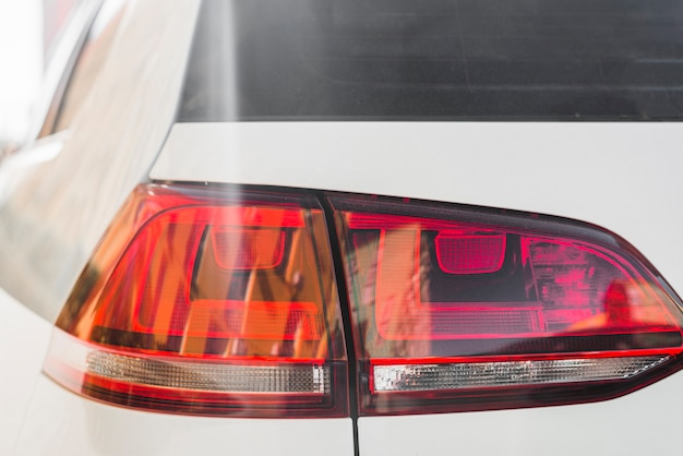 Modern rear light on white auto