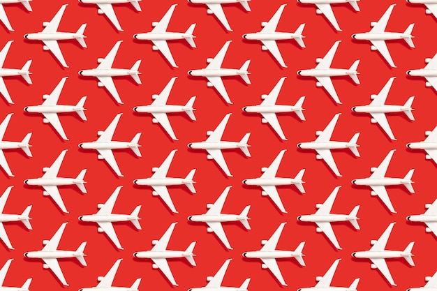 Modern red background with white airplanes. business travel.