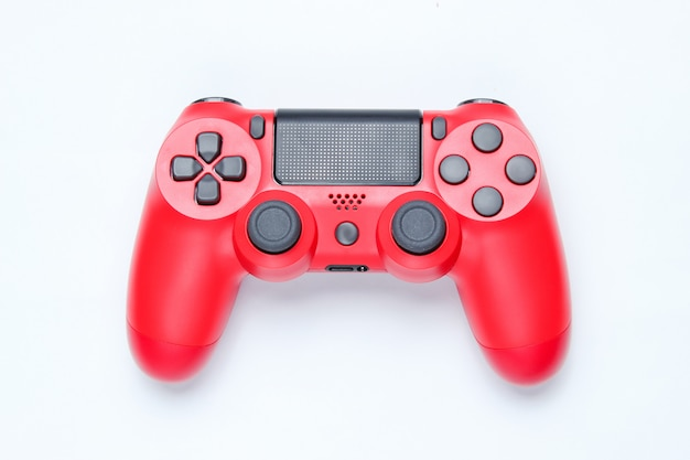 Modern red gamepad on gray background.
