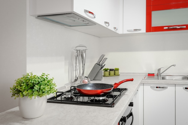 Modern red and white kitchen interior