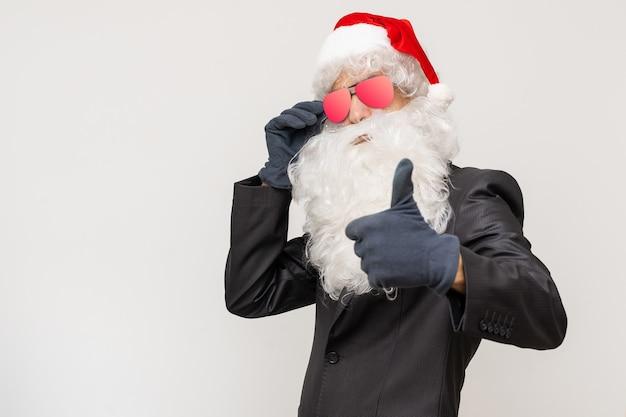 Modern santa claus in sunglasses, cool santa in suit
