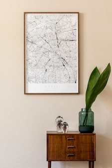 Modern scandinavian living room interior with  poster frame, design retro commode, tropical leaf in vase and elegant accessories. beige wall. japandi. . stylish home decor.