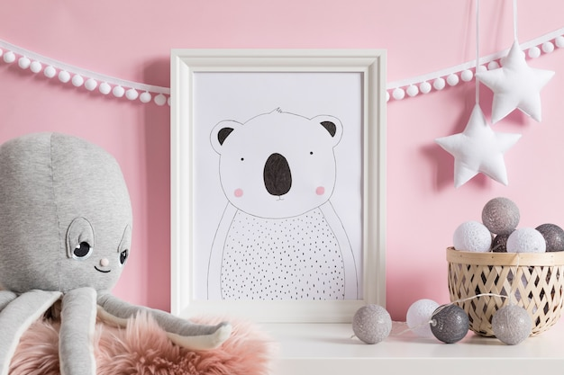 The modern scandinavian newborn baby room with frame, wooden toys, plush animals, children accessories, clouds and hanging garland