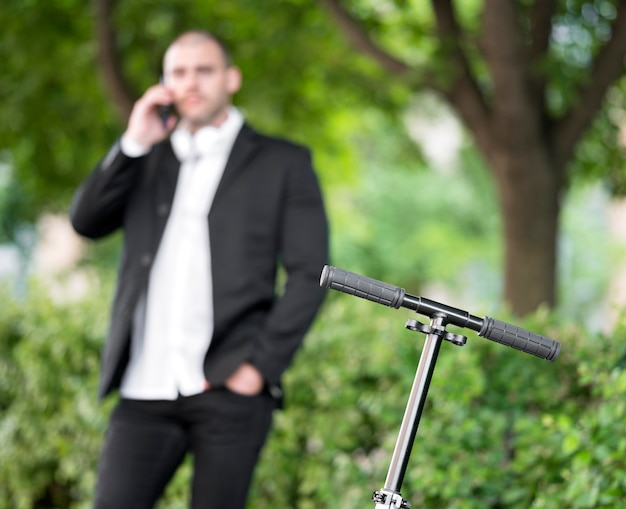 Modern scooter with businessman behind