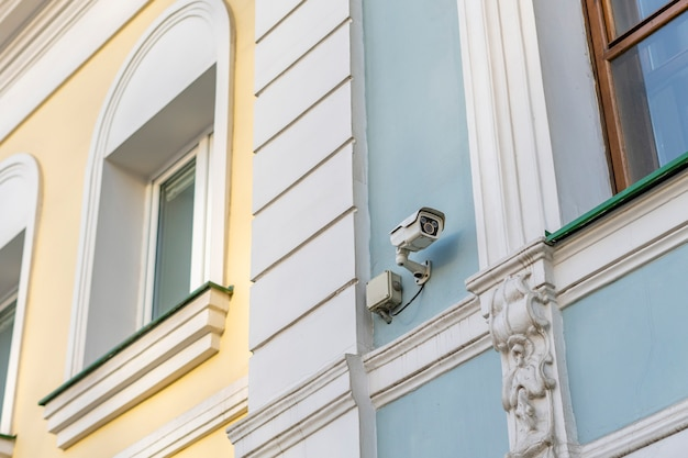 Modern security camera in city streets b