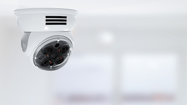Modern security cctv camera on blurred office