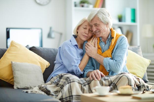 Modern senior couple at home