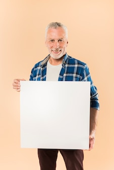 Modern senior man holding board template