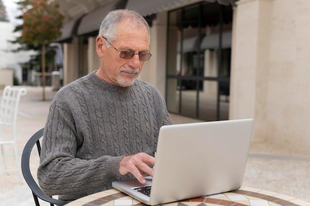 Modern senior man living in the city