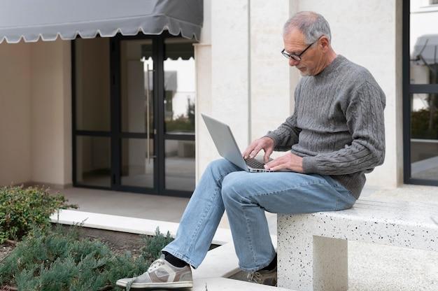 Modern senior man outdoors