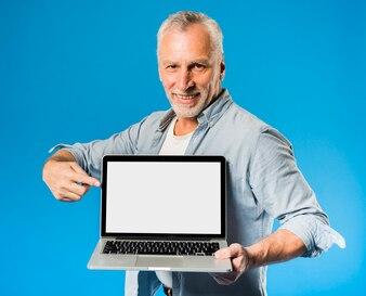 Modern senior man with laptop