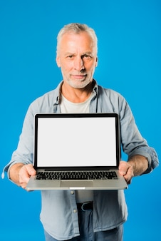 Modern senior man with laptop