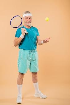 Modern senior man with tennis racket
