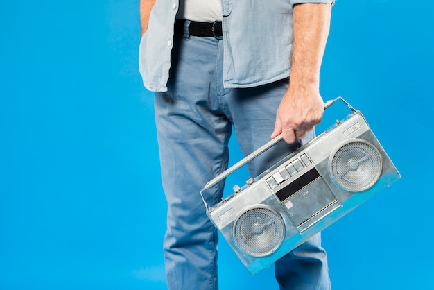 Modern senior man with vintage radio