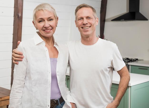 Modern senior smiley couple posing