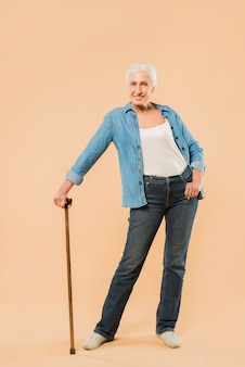 Modern senior woman with cane