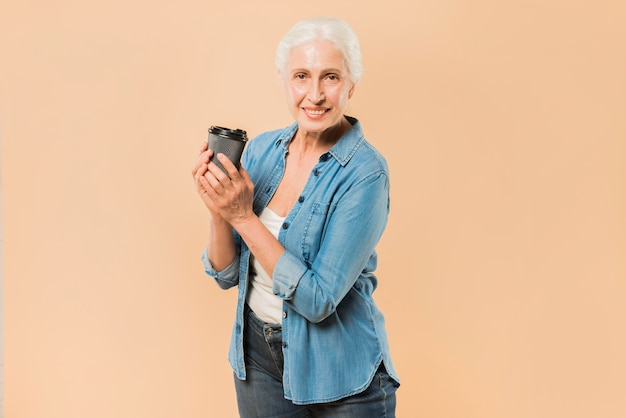Modern senior woman with coffee cup