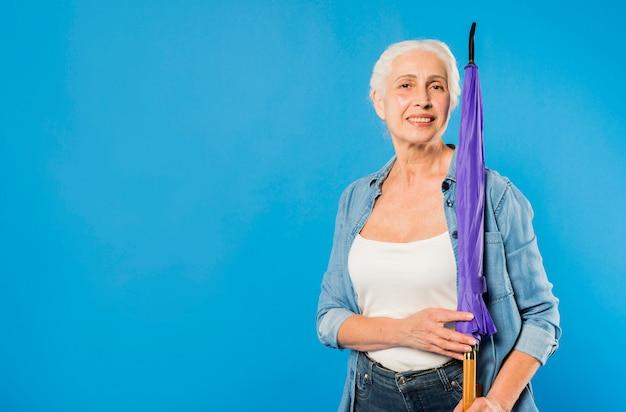 Modern senior woman with umbrella