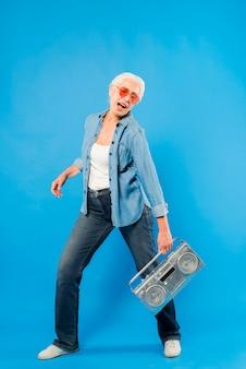 Modern senior woman with vintage radio