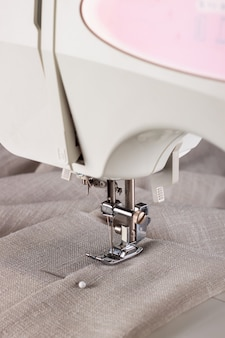 The modern sewing machine and item of clothing. sewing process.