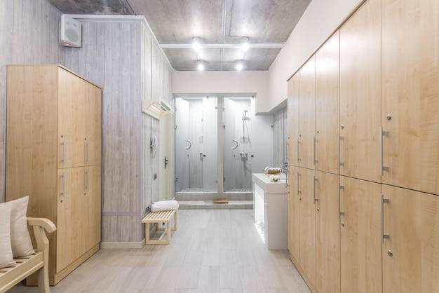 Modern shower room interior with wardrobes