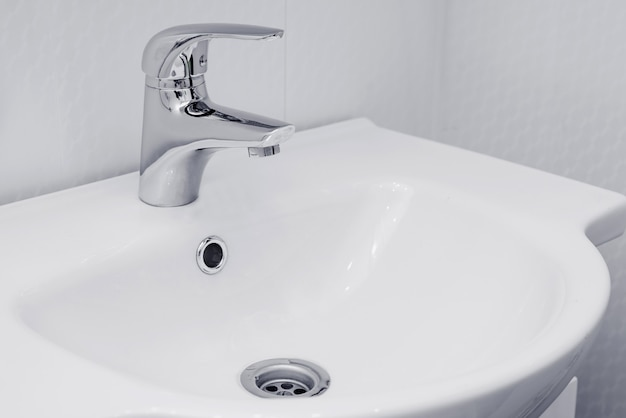 Modern sink with faucet in minimalist style.