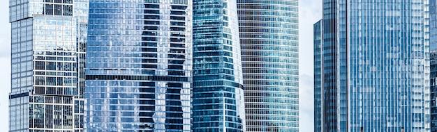 Современные здания небоскреба панорамный фон, стеклянная деталь фасада окна небоскреба