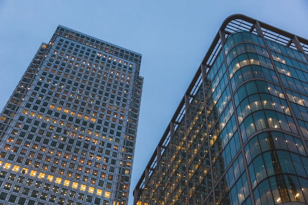 Modern skyscrapers in london at sunset, bottom view.