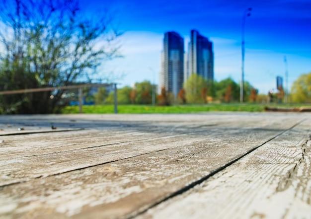 Modern skyscrapers meet old road background