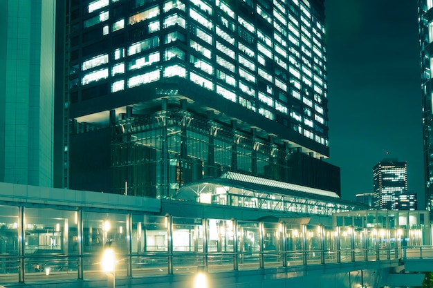 Modern skyscrapers with illuminated pathways  in tokyo shiodome district