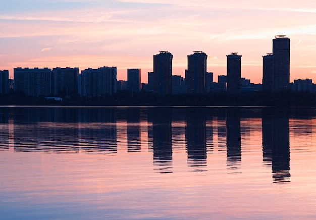 Modern skyscrapers with water reflections background