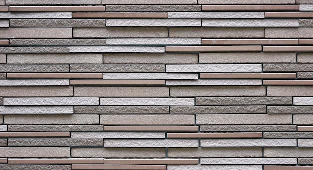 Modern slim design brick block masonry fence wall texture background.
