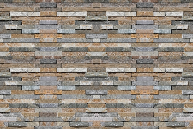 Modern slim design marble stone brick block masonry fence wall texture background.