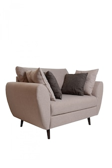 Modern small grey fabric sofa with pillows isolated on white.