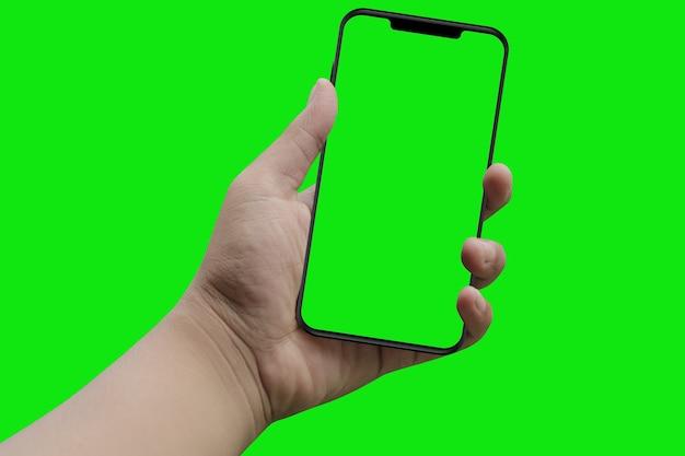 손에 현대 스마트 폰입니다. 녹색 화면 및 배경