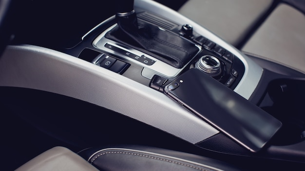 Modern smartphone in the interior of a car