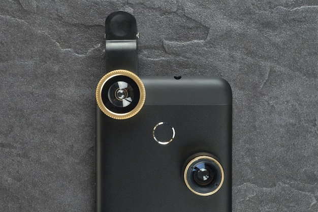 Modern smartphone with an extra lens. the view from the top.