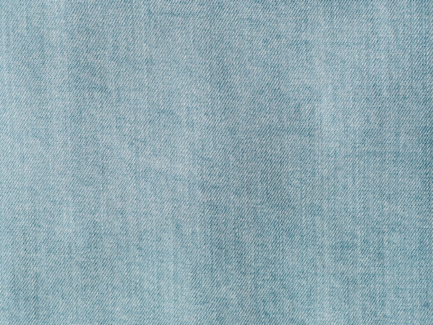 Modern soft jeans blouse texture close up. lyocell or tencel pattern - modern natural cellulose fabric blue denim color. can use for design or text. copy space