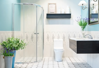 Modern Spacious Bathroom With Bright Tiles Glass Shower Toilet And Sink Side View
