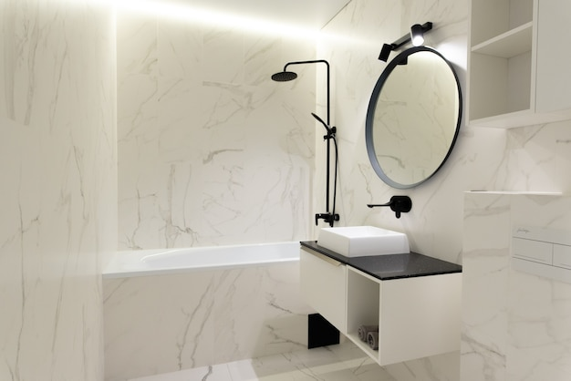Modern spacious bathroom with marble tiles with a crisp white toilet
