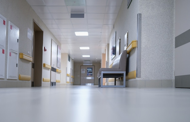 Modern spacious hospital corridor with comfortable couches for patients