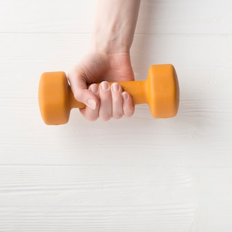 Modern sport composition with dumbbell