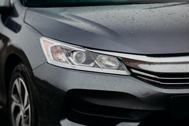 Modern sports auto headlights close up.