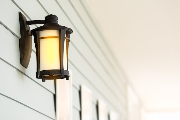 Modern steel electric lamp hold on the wall