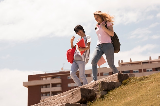 Modern students on steps in sunlight