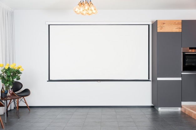 Modern studio interior with lights on projector screen. contemporary interior with loft elements.