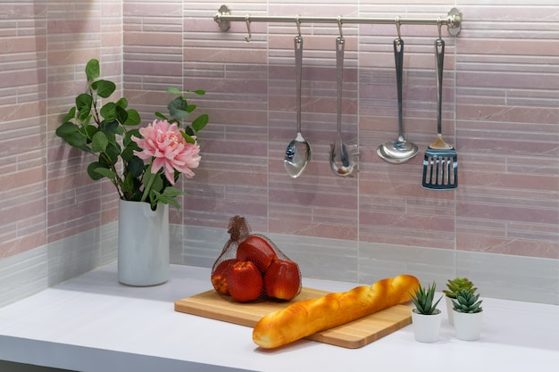 A modern style mini kitchen room interior with some foods.